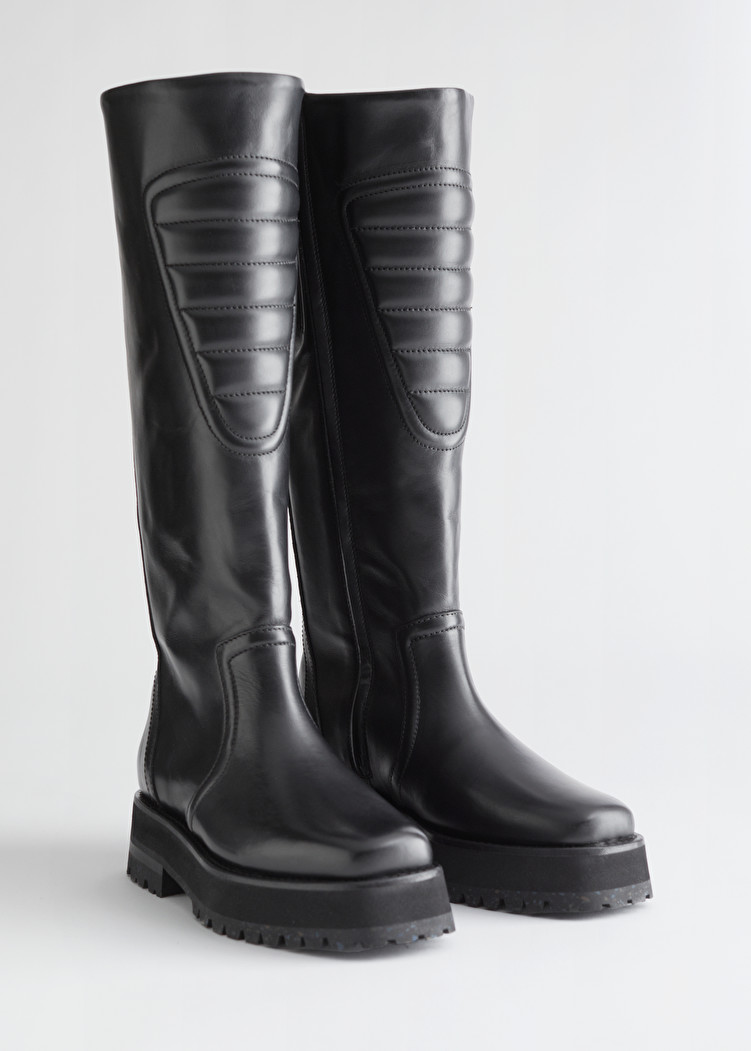"<br><br><strong>& Other Stories</strong> Topstitched Tall Leather Boots, $, available at <a href=""https://go.skimresources.com/?id=30283X879131&url=https%3A%2F%2Fwww.stories.com%2Fen_usd%2Fshoes%2Fboots%2Fknee-high-boots%2Fproduct.topstitched-tall-leather-boots-black.0912691001.html"" rel=""nofollow noopener"" target=""_blank"" data-ylk=""slk:& Other Stories"" class=""link rapid-noclick-resp"">& Other Stories</a><span class=""copyright"">Photo Courtesy of & Other Stories.</span>"