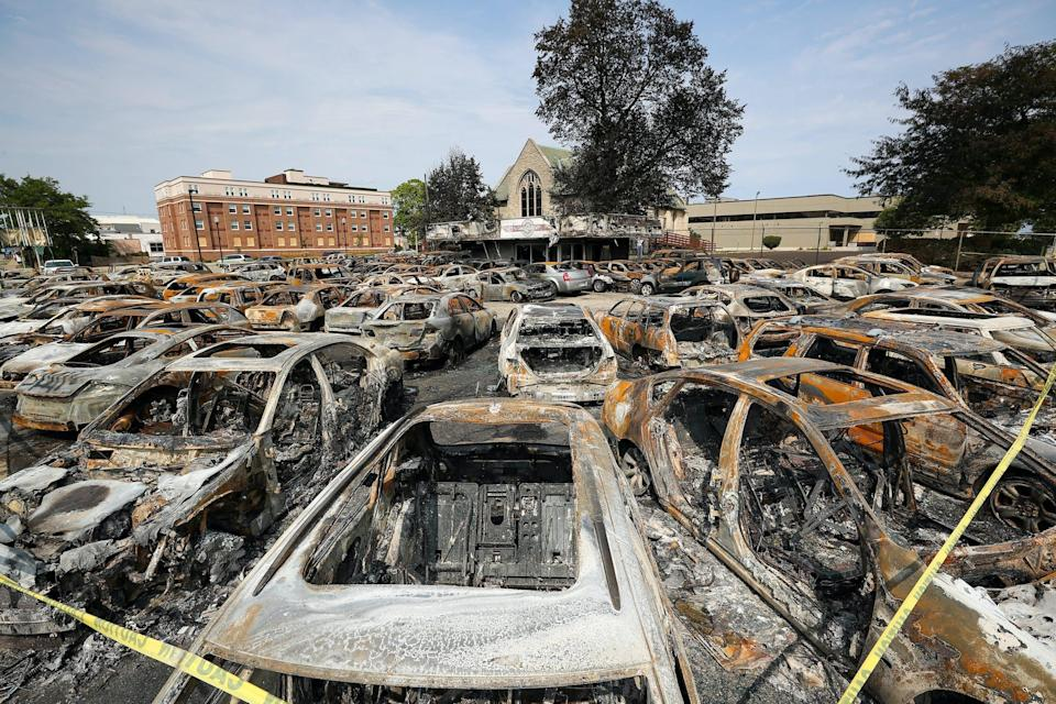 burned cars at a dealership in kenosha that was hit by riots