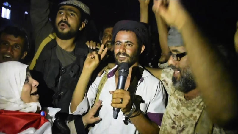 In this Friday Aug. 9, 2019 frame grab from video, Southern Transitional Council separatist fighters and supporters celebrate the storming of the presidential palace in the southern port city of Aden, Yemen. The separatists backed by the United Arab Emirates began withdrawing Sunday from positions they seized from the internationally-recognized government in Aden. Both the southern separatists and the government forces are ostensibly allies in the Saudi-led military coalition that's been battling the Houthi rebels in northern Yemen since 2015, but the four days of fighting in Aden have exposed a major rift in the alliance. (AP Photo)