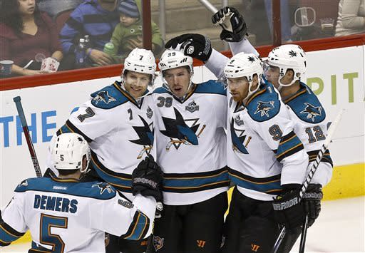 San Jose Sharks' Logan Couture (39) celebrates his goal against the Phoenix Coyotes with teammates Jason Demers (5), Brad Stuart (7), Martin Havlat (9), of the Czech Republic, and Patrick Marleau (12) in the second period during an NHL hockey game, on Monday, April 15, 2013 in Glendale, Ariz. (AP Photo/Ross D. Franklin)