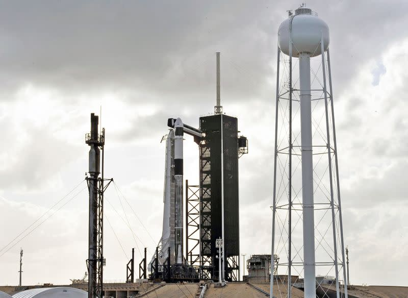The SpaceX Crew Dragon sits atop a Falcon 9 booster rocket on Pad 39A at Kennedy Space Center before a scheduled in-flight abort test at Cape Canaveral