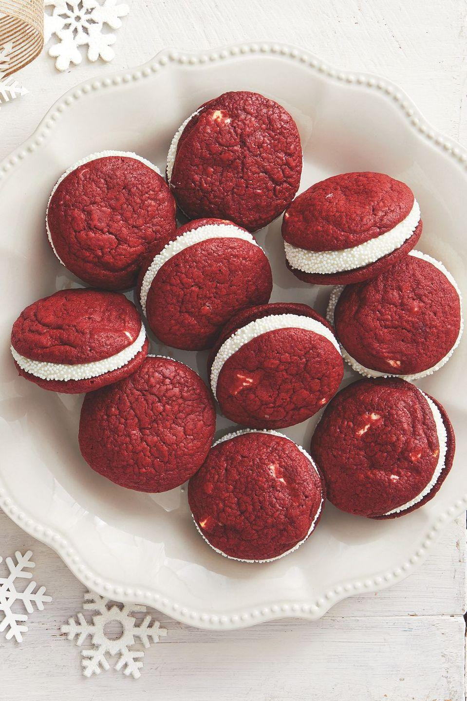 "<p>Not a cake person? These soft, red velvet cookies will make you—and your birthday party guests—swoon. </p><p><strong><a href=""https://www.thepioneerwoman.com/food-cooking/recipes/a34145278/red-velvet-sandwich-cookies-recipe/"" rel=""nofollow noopener"" target=""_blank"" data-ylk=""slk:Get Ree's recipe."" class=""link rapid-noclick-resp"">Get Ree's recipe.</a></strong></p><p><a class=""link rapid-noclick-resp"" href=""https://go.redirectingat.com?id=74968X1596630&url=https%3A%2F%2Fwww.walmart.com%2Fip%2F2-pack-Great-Value-Non-Pareil-Sprinkles-White-3-15-oz%2F514679959&sref=https%3A%2F%2Fwww.thepioneerwoman.com%2Fhome-lifestyle%2Fentertaining%2Fg34192298%2F50th-birthday-party-ideas%2F"" rel=""nofollow noopener"" target=""_blank"" data-ylk=""slk:SHOP WHITE NONPAREILS"">SHOP WHITE NONPAREILS </a></p>"