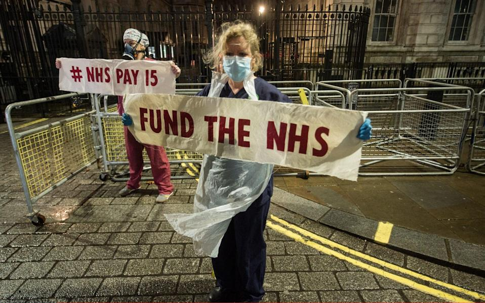 NHS workers from St Thomas's Hospital, including ICU staff, protest at the gates of Downing Street against cuts to health care - Guy Smallman/Getty Images Europe
