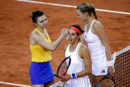Tennis - Fed Cup - World Group Semi-Final - France v Romania - Kindarena, Rouen, France - April 21, 2019 France's Kristina Mladenovic and Caroline Garcia shakes hands with Romania's Simona Halep after winning their doubles match with Monica Niculescu REUTERS/Charles Platiau