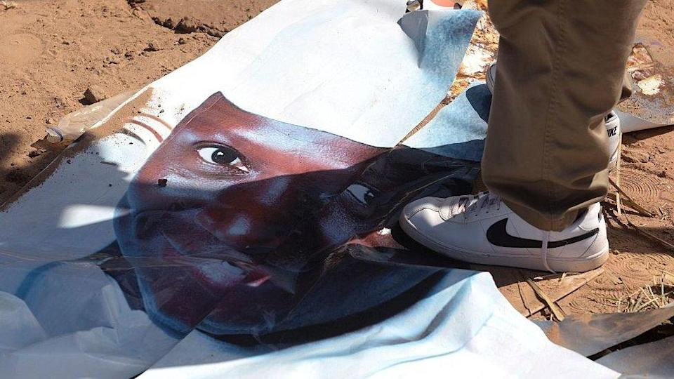 A poster of Yahya Jammeh underfoot after his election defeat