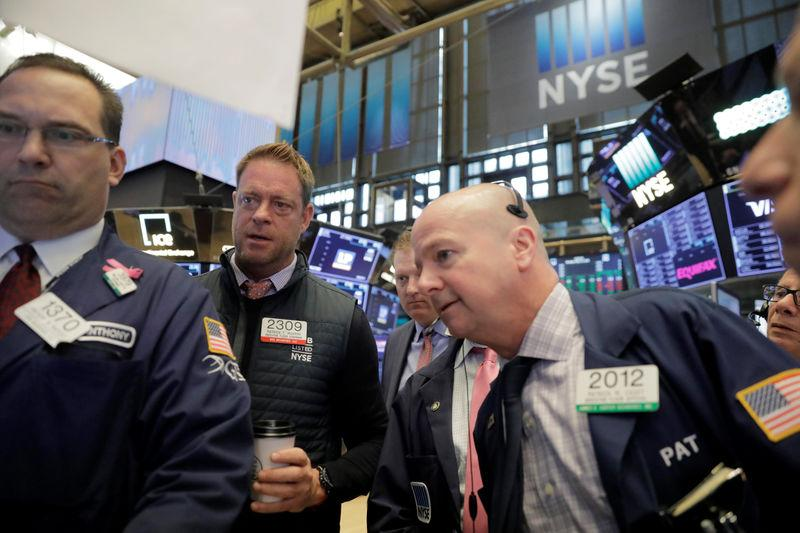 Traders work on the floor of the New York Stock Exchange shortly after the opening bell in New York, U.S., May 14, 2018. REUTERS/Lucas Jackson