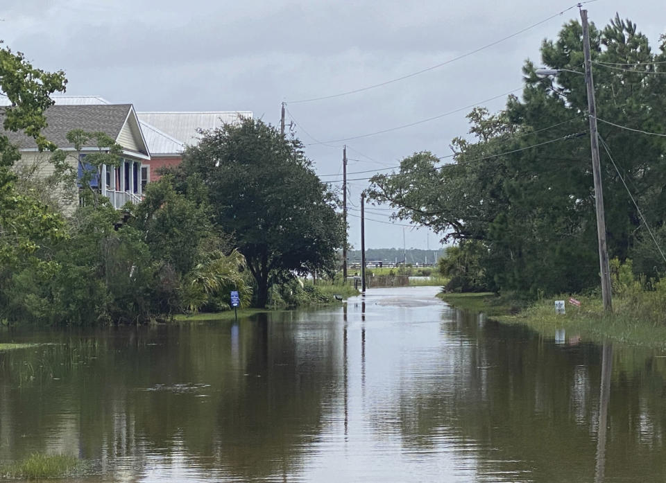 Clark Street in Pass Christian, Miss. is completely flooded after the torrential downpour from Hurricane Ida on Monday, Aug. 30, 2021. (Hunter Dawkins/The Gazebo Gazette via AP)