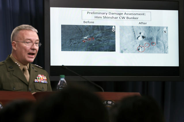 <p>Marine Lt. Gen. Kenneth F. McKenzie Jr., director, Joint Staff, speaks as he shows photographs from before and after the U.S.-led airstrikes against Syria during a media availability at the Pentagon, Saturday, April 14, 2018, in Washington. (Photo: Alex Brandon/AP) </p>