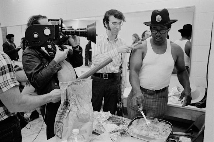 <p>Bo Diddley cooks fried chicken before a concert at Madison Square Garden in 1972, while being interviewed pre-show.</p>