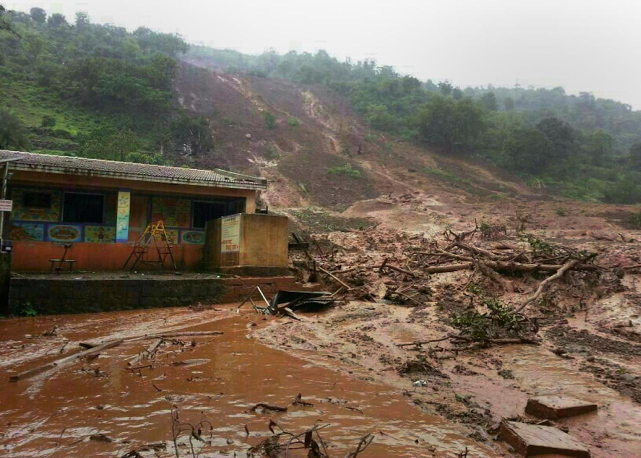 A mudslide surrounds a building in Malin village in Pune district the western Indian state of Maharashtra on July 30, 2014 (AFP Photo/)