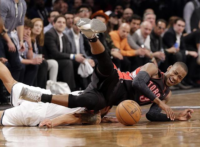 Toronto Raptors' Terrence Ross, right, and Brooklyn Nets' Deron Williams tumble to the court during the first half of Game 3 of an NBA basketball first-round playoff series Friday, April 25, 2014, in New York. (AP Photo/Frank Franklin II)