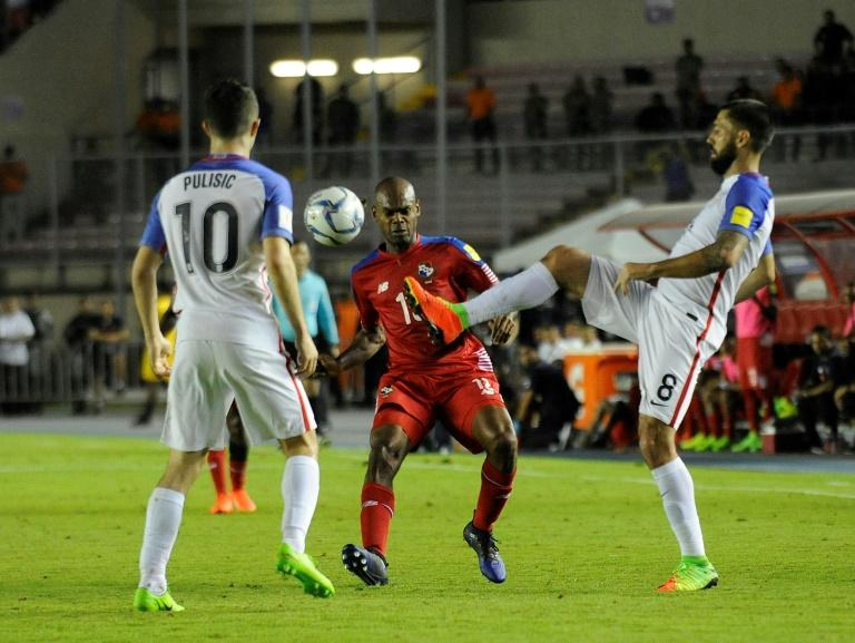 Clint Dempsey (R) and Christian Pulisic of the US fight for the ball with Panama's Adolfo Machado during their Russia 2018 World Cup qualifier match, in Panama City, on March 28, 2017