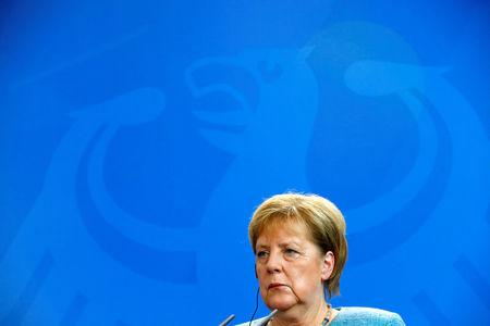 FILE PHOTO: German Chancellor Angela Merkel attends a news conference with Chilean President Sebastian Pinera in Berlin