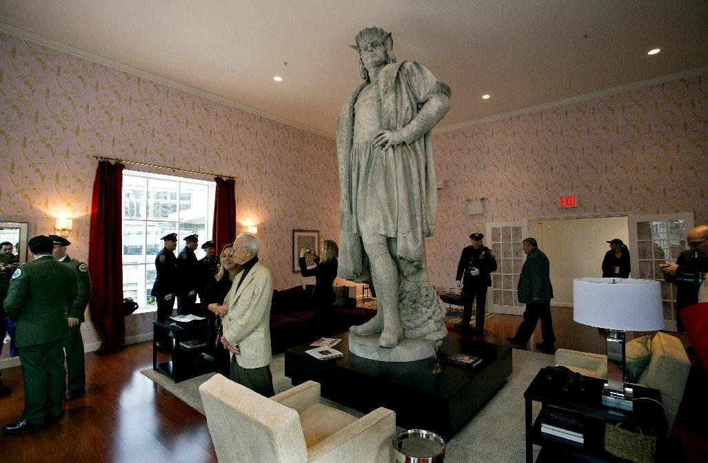 "Leaders of the Italian-American community, civil servants from New York, including police and sanitation workers and other guests, stand in what is known as the living room created by artist Tatzu Nishi that surrounds Gaetano Russo's 1892 sculpture of Christopher Columbus 75 Feet Above Columbus Circle Sunday, Oct. 7, 2012, in New York. The art installation ""Tatzu Nishi: Discovering Columbus,"" which brings people to eye level with the Columbus statue, became part of an annual wreath laying ceremony that celebrates Columbus Day. (AP Photo/Craig Ruttle)"