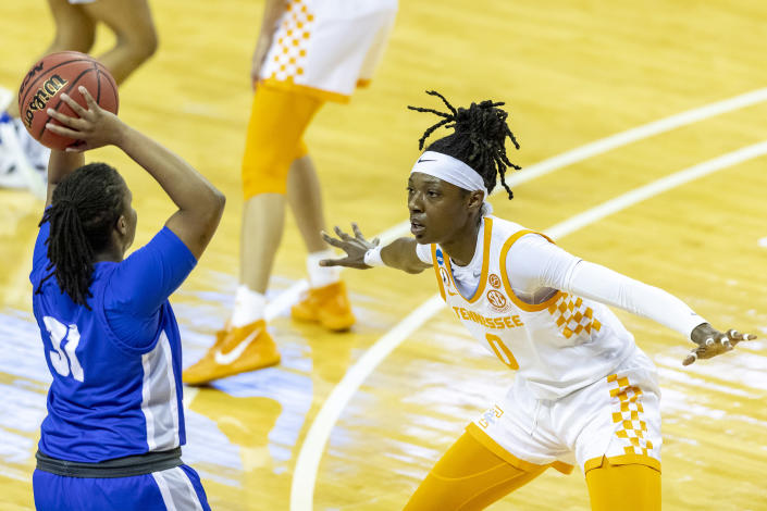 Tennessee guard Rennia Davis, right, defends Middle Tennessee State guard Deja Cage during the first half of a college basketball game in the first round of the women's NCAA basketball tournament at the Frank Erwin Center in Austin, Texas, Sunday, March 21, 2021. (AP Photo/Stephen Spillman)
