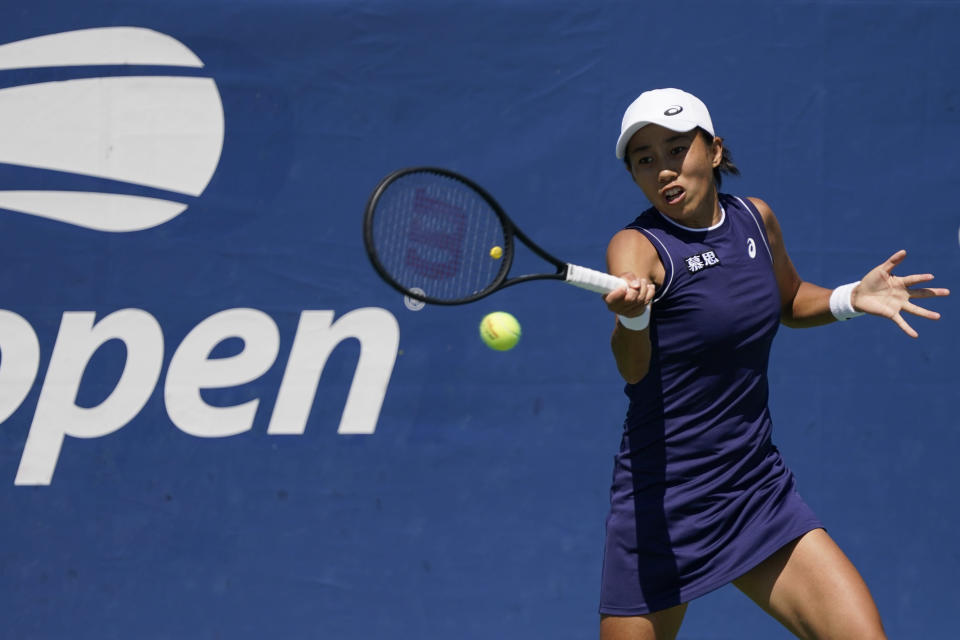 Shuai Zhang, of China, hits to Emma Raducanu, from Britain, during the second round of the US Open tennis championships, Thursday, Sept. 2, 2021, (AP Photo/Seth Wenig)
