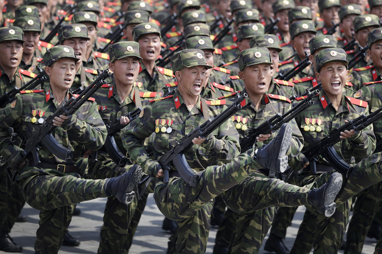 <p>Soldiers goose-step across Kim Il Sung Square in Pyongyang, North Korea, during a parade to celebrate the 105th birth anniversary of Kim Il Sung, the country's late founder and grandfather of current ruler Kim Jong Un on April 15, 2017. The message of the parade is clear: North Korea is, or is near to being, able to launch a pre-emptive strike against a regional target. It is preparing to withstand a retaliatory follow-up attack if it does, and it is building the arsenal it needs to then launch a second wave of strikes, this time at the U.S. mainland. (Photo: Wong Maye-E/AP) </p>