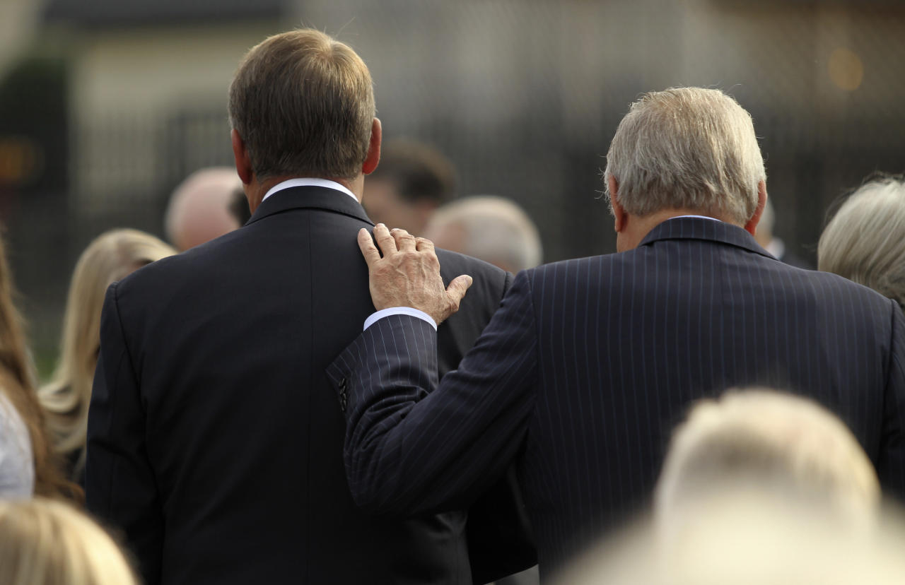 Former U.S. Secretary of Defense Donald Rumsfeld (R) puts his hand on the shoulder of Speaker of the House John Boehner (L) as they gather for ceremonies marking the 10th anniversary of the 9/11 attacks on the Pentagon, in Washington September 11, 2011.  (REUTERS/Molly Riley)