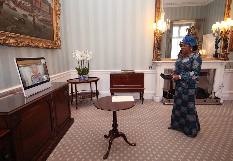 LONDON, ENGLAND - APRIL 27: Queen Elizabeth II appears on a screen by videolink from Windsor Castle, where she is in residence, during a virtual audience to receive Her Excellency Sara Affoue Amani, the Ambassador of Cote d'Ivoire at Buckingham Palace on April 27, 2021 in London, England. (Photo by Yui Mok - Pool/Getty Images)