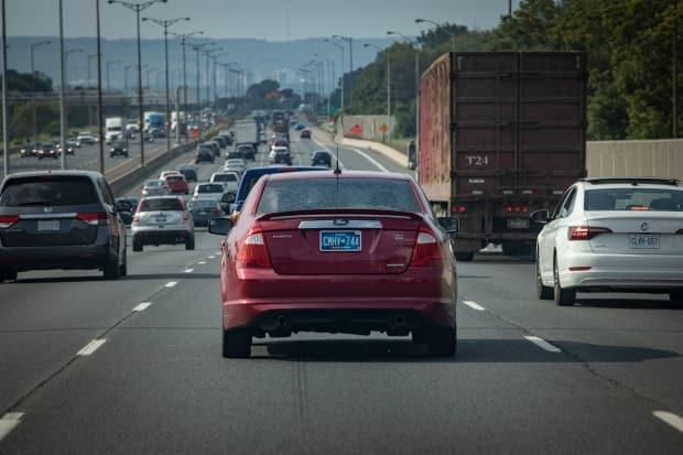 Still seeing blue licence plates on the highway? You might be for some time longer, as the province still doesn't have a plan to replace the plates, which have been criticized due to visibility issues in certain conditions. (Evan Mitsui/CBC - image credit)