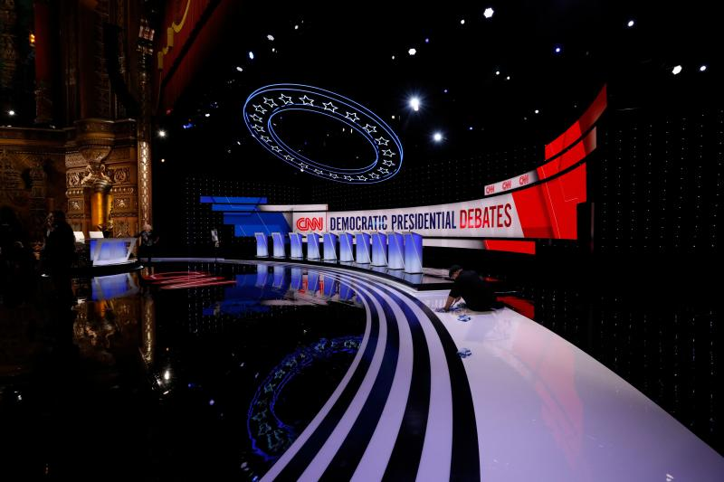 Workers prepare the debate stage at the Fox Theater in Detroit