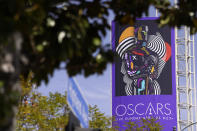 A sign advertising this year's Oscars ceremony is pictured near the Dolby Theatre, Thursday, April 15, 2021, in Los Angeles. The Dolby Theatre is one of the locations being used for the 93rd Academy Awards on Sunday, April 25. (AP Photo/Chris Pizzello)