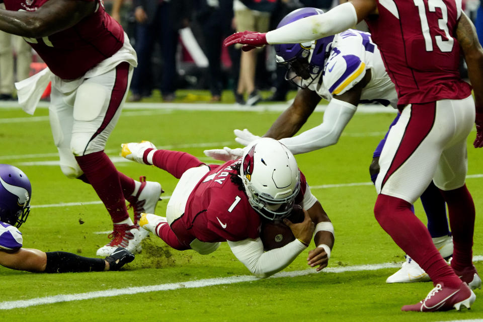 Arizona Cardinals quarterback Kyler Murray (1) dives in for a touchdown against the Minnesota Vikings during the first half of an NFL football game, Sunday, Sept. 19, 2021, in Glendale, Ariz. (AP Photo/Rick Scuteri)