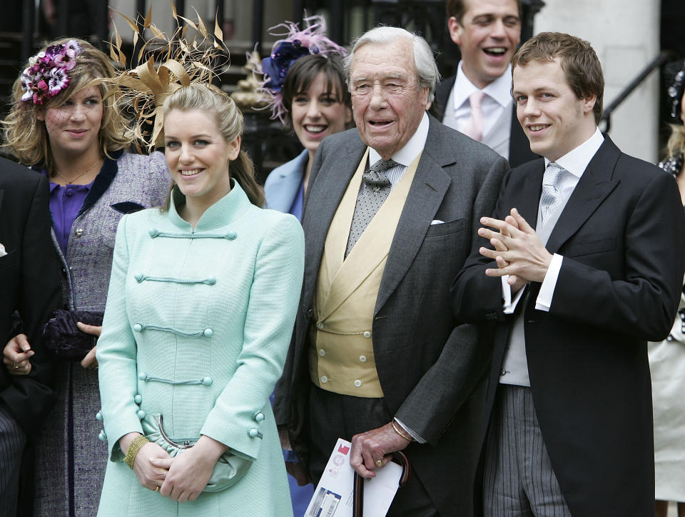 WINDSOR, ENGLAND- APRIL 09:  (L-R) Laura Parker Bowles, Major Bruce Shand and Tom Parker Bowles depart the Civil Ceremony following the marriage between HRH Prince Charles & Mrs Camilla Parker Bowles, at The Guildhall, Windsor on April 9, 2005 in Berkshire, England.  (Photo by Georges De Keerle/Getty Images)