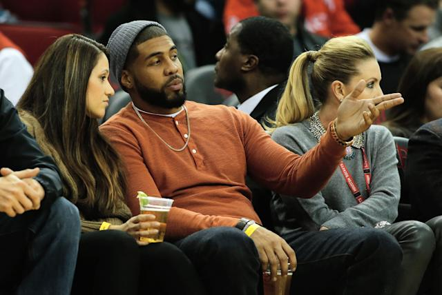 HOUSTON, TX - DECEMBER 06: Houston Texans running back Arian Foster sits with his wife Romina during the game against the Golden State Warriors at Toyota Center on December 6, 2013 in Houston, Texas. NOTE TO USER: User expressly acknowledges and agrees that, by downloading and or using this photograph, User is consenting to the terms and conditions of the Getty Images License Agreement. (Photo by Scott Halleran/Getty Images)