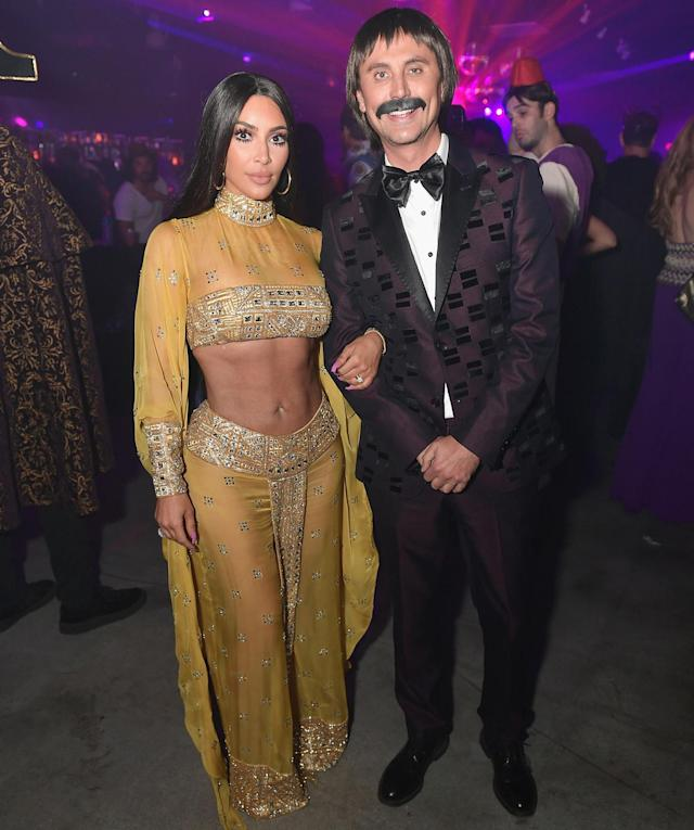 Kim Kardashian paid homage to her favorite style icon, Cher, as she kicked off Halloween weekend with Jonathan Cheban. (Photo: Getty Images)