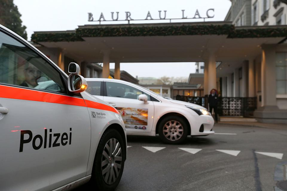 A police car is driving on December 3, 2015 in front of the entrance of the Hotel Baur au Lac in Zurich, where Swiss authorities have conducted an early-morning operation to arrest several FIFA football officials. The Swiss government said two FIFA officials were detained in Zurich on December 3 ,confirming reports of newarrests in the broadening FIFA scandal, and said they were suspected of accepting millions of dollars in bribes.  / AFP / MICHELE LIMINA        (Photo credit should read MICHELE LIMINA/AFP via Getty Images)