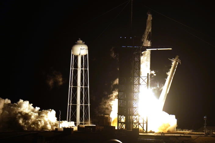 A SpaceX Falcon9 rocket, with the Crew Dragon capsule attached, lift's off from Kennedy Space Center's Launch Complex 39-A Sunday Nov. 15, 2020, in Cape Canaveral, Fla. Four astronauts are beginning a mission to the international Space Station. (AP Photo/Chris O'Meara)