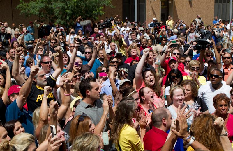 People react to a Jodi Arias' guilty verdict outside of Maricopa County Superior Court.