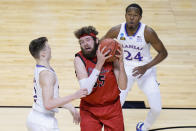 Eastern Washington forward Tanner Groves (35) is pressured by Kansas guard Christian Braun, left, and Kansas guard Bryce Thompson (24) as he goes up for a shot during the second half of a first-round game in the NCAA college basketball tournament at Farmers Coliseum in Indianapolis, Saturday, March 20, 2021. (AP Photo/AJ Mast)