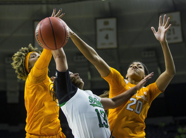 Notre Dame's Marta Sniezek (13) gets blocked by Tennessee's Jazmine Massengill (13) and Tamari Key (20) during an NCAA college basketball game in South Bend, Ind., Monday, Nov. 11, 2019. (Michael Caterina/South Bend Tribune via AP)