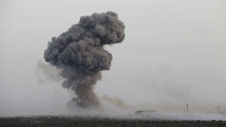 Smoke rises from Qarmeed camp after who Islamist rebel fighters said was a suicide bomber from al Qaeda's Nusra Front drove a truck packed with explosives into the compound and blew it up, in northwestern Idlib province