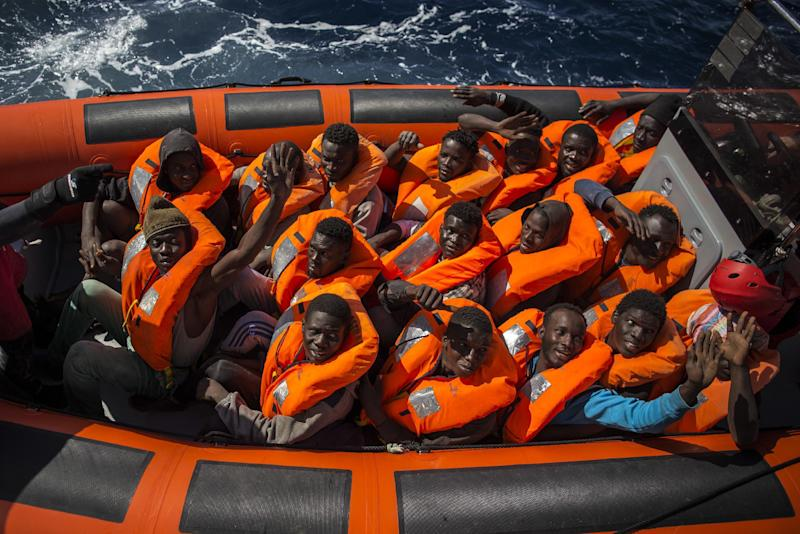 A rescue team of the Spanish NGO Proactiva Open Arms transfers refugees and migrants, from different African countries, from the overcrowded rubber boats on which they had left Libya to an Italian Military Ship, about 20 miles North of Sabratha, Libya, Saturday, March 4, 2017. A rescue ship belonging to a Spanish NGO has saved 250 migrants in danger of capsizing near the Libyan coast on Saturday. Proactiva Open Arms spokesperson Laura Lanuza says that the NGO's boat rescued the African migrants from two small rubber vessels that were at risk of being overwhelmed by the sea. (AP Photo/Santi Palacios)
