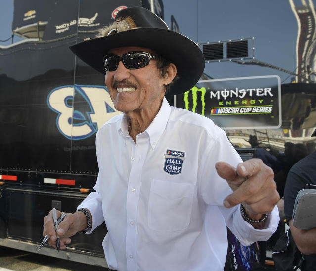 Richard Petty smiles as he signs autographs during practice for the NASCAR Daytona 500 Cup Series auto race at Daytona International Speedway in Daytona Beach, Fla., Saturday, Feb. 17, 2018. (AP Photo)