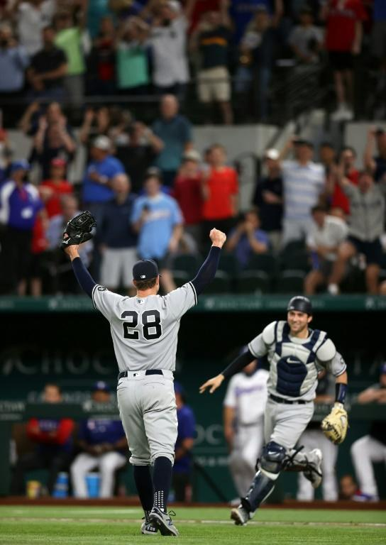 New York Yankees pitcher Corey Kluber celebrates his no-hitter against the Texas Rangers with catcher Kyle Higashioka