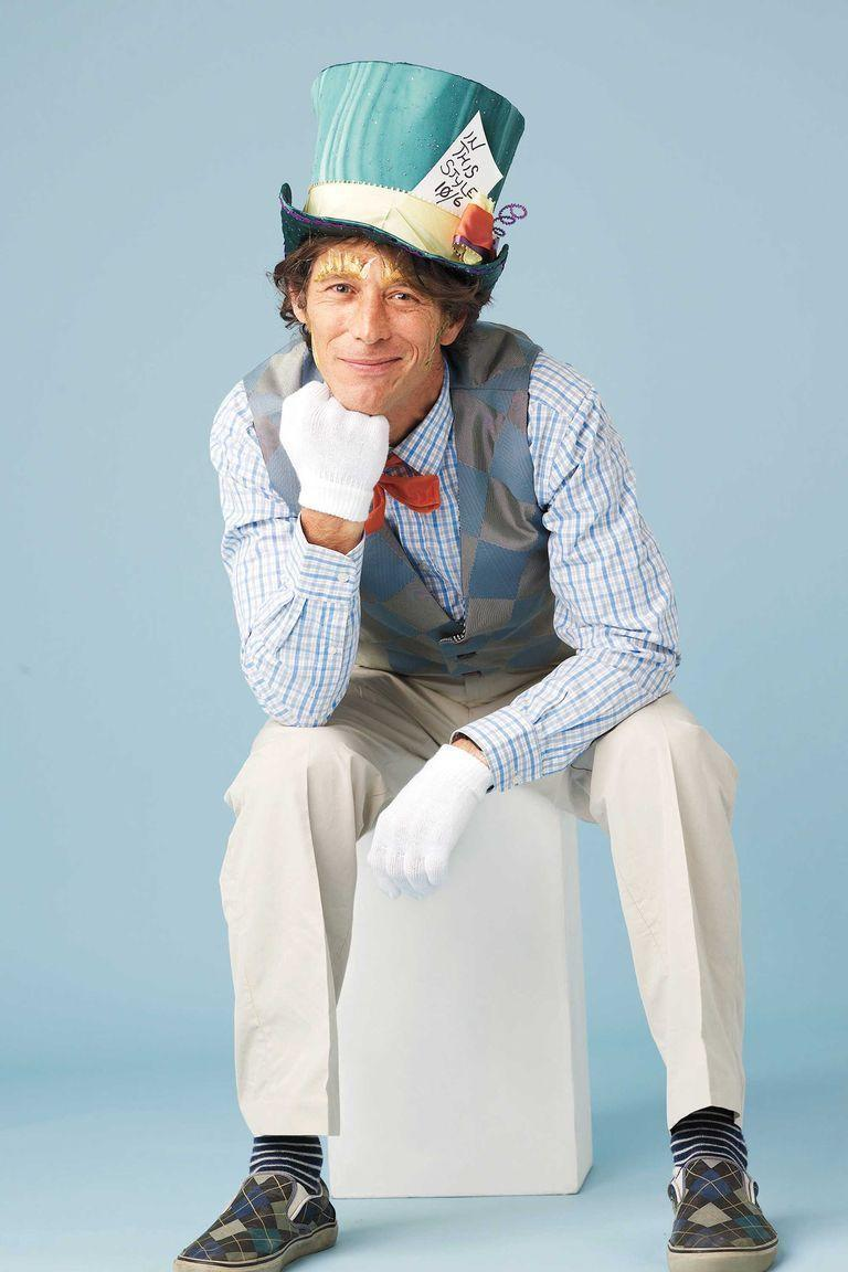 """<p>To make your own Mad Hatter's hat, wrap 1⁄2 yard of three-inch-wide yellow ribbon around a green top hat and glue into place. Then, tuck a piece of card stock that reads """"In This Style: 10⁄6"""" into the hatband. Complete your look with a checkered vest, khaki pants, striped socks, and checkered sneakers.</p><p><a class=""""link rapid-noclick-resp"""" href=""""https://www.amazon.com/Dress-Party-Costume-TOP-Green/dp/B015HNJWS0?tag=syn-yahoo-20&ascsubtag=%5Bartid%7C10070.g.490%5Bsrc%7Cyahoo-us"""" rel=""""nofollow noopener"""" target=""""_blank"""" data-ylk=""""slk:SHOP GREEN TOP HATS"""">SHOP GREEN TOP HATS</a></p>"""