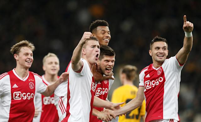 Ajax players celebrate the second goal from Dusan Tadic (right) against AEK on Tuesday. (Getty)