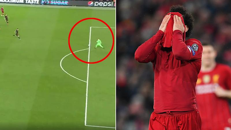 Liverpool goalkeeper Adrian (pictured left) goes to kick the ball ands Mohammad Salah (pictured right) covers his face in frustration.