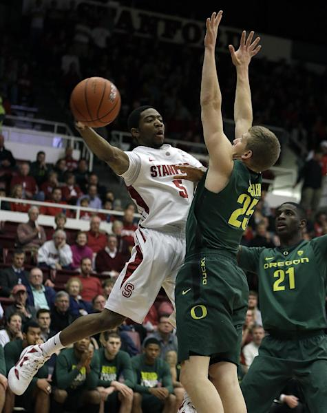 Stanford's Chasson Randle, left, looks to pass away from Oregon's E.J. Singler during the first half of an NCAA college basketball game Wednesday, Jan. 30, 2013, in Stanford, Calif. (AP Photo/Ben Margot)