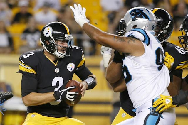 Pittsburgh Steelers quarterback Landry Jones (3) evades pressure by Carolina Panthers defensive end Charles Johnson (95) in the second quarter of a NFL preseason football game on Thursday, Aug. 28, 2014 in Pittsburgh. (AP Photo/Gene Puskar)