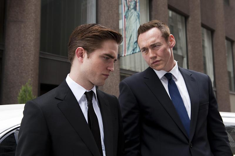 """FILE - This undated publicity film image released by Entertainment One shows Robert Pattinson, left, and Kevin Durand in a scene from """"Cosmopolis."""" (AP Photo/Entertainment One, Caitlin Cronenberg, File)"""