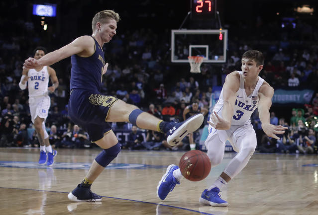 Duke guard Grayson Allen (3) passes the ball around Notre Dame guard Rex Pflueger (0) during the second half of an NCAA college basketball game in the Atlantic Coast Conference men's tournament Thursday, March 8, 2018, in New York. Duke won 88-70. (AP Photo/Julie Jacobson)