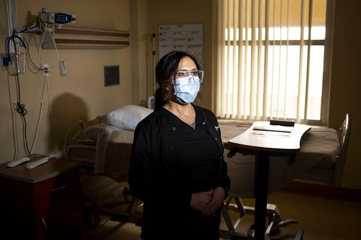 Regina Villa, the nurse manager at Valleywise Health Medical Center in Phoenix, says she heard that the second wave of the 1918 influenza pandemic was more deadly than the first but did not believe that would happen with the coronavirus.