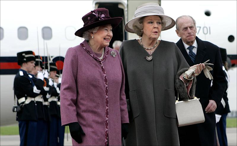 FILE- In this Monday, Feb. 5, 2007 file photo, Britain's Queen Elizabeth II, left, is greeted by Netherlands' Queen Beatrix, center, as Britain's Prince Philip is seen rear right, upon the arrival of the British royal couple at Rotterdam airport, Netherlands. The Dutch Royal House says Queen Beatrix will deliver a nationally televised speech, on Monday, Jan. 28, 2013, and speculation is growing that the popular monarch will announce she is to abdicate. Beatrix, who turns 75 on Thursday, has ruled this nation of 16 million for more than 32 years and would be succeeded by her eldest son, Crown Prince Willem-Alexander. (AP Photo/Robin Utrecht, Pool, File)