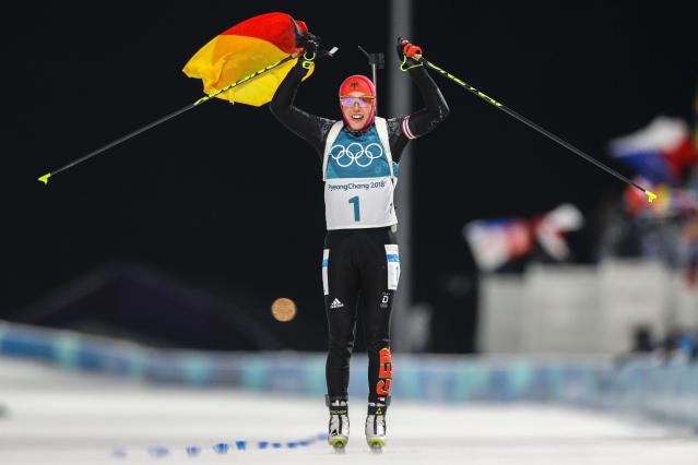 <p>Laura Dahlmeier, of Germany, crosses the finish line to win the gold medal in the women's 10-kilometer biathlon pursuit at the 2018 Winter Olympics in Pyeongchang, South Korea, Monday, Feb. 12, 2018. (AP Photo/Andrew Medichini) </p>