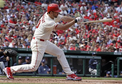 St. Louis Cardinals' Adam Wainwright hits an RBI single during the third inning of a baseball game against the Milwaukee Brewers, Saturday, April 13, 2013, in St. Louis. (AP Photo/Jeff Roberson)